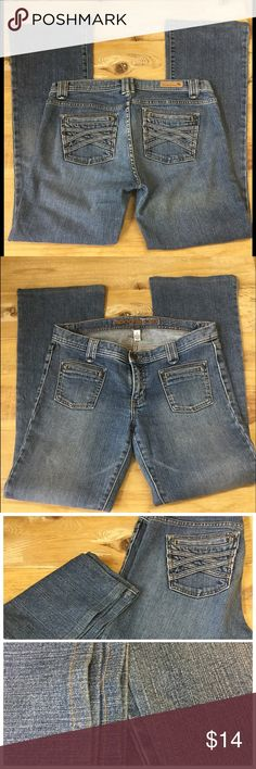 "ABERCROMBIE & FITCH BOOT CUT JEANS Abercrombie & Fitch boot cut jeans. Distressed denim criss cross detailing on back pockets. Slit front pockets. Inseam 30"" good condition. Abercrombie & Fitch Jeans Boot Cut"