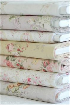 I see floral print sheets at thirft stores ALL the time. These would make great tablecloths, and could be gathered in pick-ups with ribbon to decorate potluck tables.