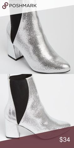 SASSY SEXY Silver Crushed Metallic Booties 10 7.5 Treat the streets like your personal runway in these stylish heeled booties! Made of crushed metallic faux leather, it features a double gored striped upper and a chunky heel for an edgy finish.  Heel: 3 in. Double gore upper Non-skid sole Rue21 Shoes Ankle Boots & Booties