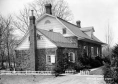 Zabriskie House, Dumont, New Jersey, 1760 rural tradition Dutch Colonial. The smaller portion in the foreground without the flared eaves is the original house. The larger portion of the home was an 1810 addition. The wide overhanging gambrel roof was an 1800's development.