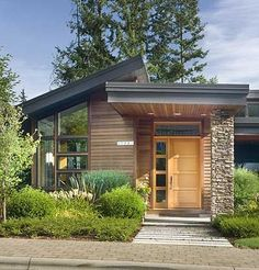 Not a fan of this dramatic roof slope. Plan W69402AM: Northwest, Contemporary, Photo Gallery, Luxury, Premium Collection House Plans & Home Designs