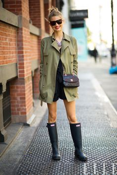 Street Chic Daily  Natalie wears aCéline trench, Forever 21 romper, Hunter boots and a Chanel bag in New York City.  Photo:Adam Katz Sinding/Le 21ème Arrondissement