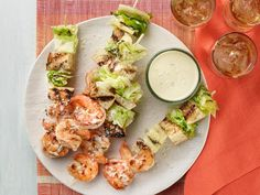 Grilled shrimp and caesar salad skewers