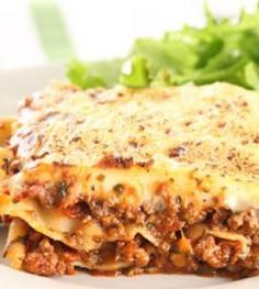 This Classic Lasagne recipe is comfort food at its best Ingredients 45 ml olive oil 2 large onions, chopped 4 garlic cloves, chopped 2 carrots, grated 2 celery sticks, chopped … South African Dishes, South African Recipes, Healthy Meals To Cook, Easy Meals, Healthy Recipes, Simple Recipes, Mince Recipes, Cooking Recipes, Pasta Recipes