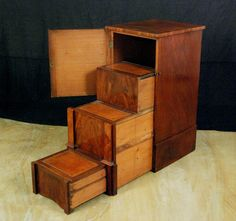 so...i have an old, tall, oak, drawerless, file cabinet. maybe i can do something like this?
