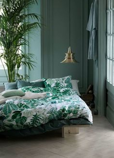 Green bedroom green paint on bedroom walls leaf pattern bedding The Life Creative