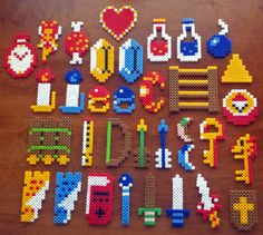 It wasn't safe to go alone, so I made and donated this complete set Legend of Zelda items to Shinobi Ninja to use on their tour. [link] Legend of Zelda Items Galore Perler Bead Designs, Perler Bead Templates, Pearler Bead Patterns, Perler Patterns, Pearler Beads, Fuse Beads, Iron Beads, The Legend Of Zelda, Melting Beads
