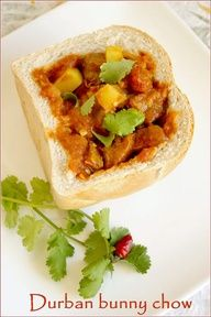 Bunny Chow - South African Street Food (basically curry in a loaf of bread) I loved eating these! South African Dishes, South African Recipes, Indian Food Recipes, Ethnic Recipes, South African Bunny Chow, Africa Recipes, Kos, Comfort Food, Love Eat