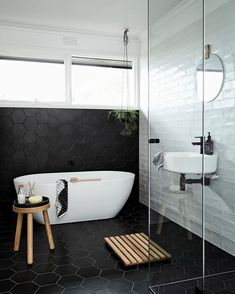 Tiles along floor and up wall? See this Instagram photo by @designstuff_group