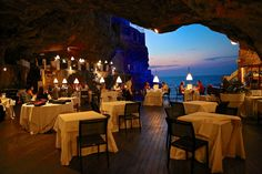 The restaurant is part of the Grotta Palazzese Hotel in the town of Polignano a Mare, which is in the Puglia region of Southern Italy.