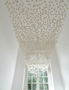 German artist Regine Ramseier created a 'Dandelion Ceiling.' 2000 dandelion flowers were treated and sprayed with a gentle adhesive to fix them.