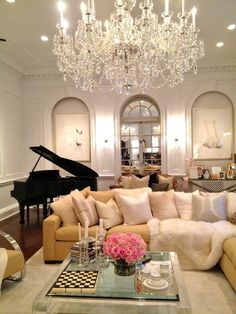 This room is just my type. Neutral colors with small pops of color. Love the piano and chandelier!
