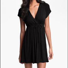 Black Surplice Coverup Dress W/ Hood Hooded soft jersey knit coverup with drawstring at elastic empire waist. Robin Piccone Dresses