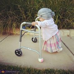 Tiny little thing dressed as an old lady...too. much. cute. (If ever she has a costume party to attend...)
