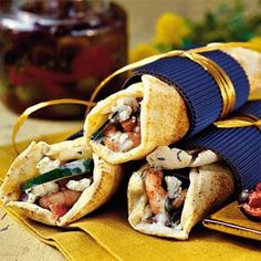 Make the most of Greek ingredients by marinating fresh shrimp in olive oil and Greek seasoning and grilling. Serve the shrimp in pita rounds topped with a savory yogurt spread, feta, cucumber, and tomato.