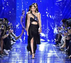 Abs-olutely fab: Gigi Hadid showed off her model proportions in two show-stopping ensemble...