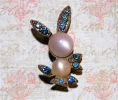 Mid Century Spring figural bunny scatter pin Pale lucite moon glow head and body, with blue rhinestone ears, tail, and legs Gold tone setting Unsigned 1 x 1 3/4 inches Great to wear with other kitsch pins Good vintage condition  International buyers welcome, I now offer 13$ flat rate jewelry shipping, over charges are refunded Priority shipping is offered 40517    Credit cards and paypal welcome..