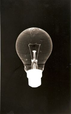 this photogram includes all three different structures of : opaque, translucent and transparent materials. the light bulb creates such a detailed image.