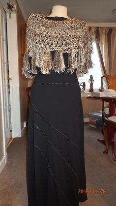 shoulder shawl hand braided worn round the shoulders in oatmeal wool