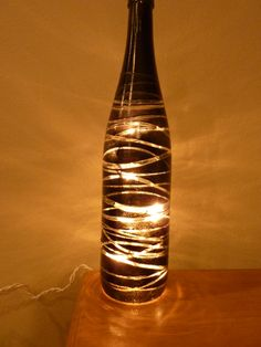 Painted wine bottle with lights...definitely a conversation starter!  From winenotanother, check out all of our products!