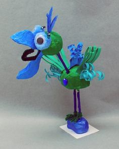 """DoDo Bird"" Sculpture. Materials: model magic, feathers, paper, gems, beads, found materials, paint, etc"
