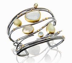 Sea Glass Twig cuff: beryl, aquamarine, Umba sapphires in the colors of sea glass. 22k gold and oxidized silver. www.sydneylynch.com #craft2wear #atlantacontemporaryjewelryshow