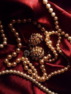 pearls on the backdrop of burgandy