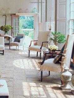 rustic white.  Lovely white living room, linen slip covers, stone floors, white shutters