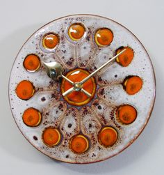 A MCM glazed pottery or ceramic tile wall clock fusing imagination and style, circa 1970. The concept, the tiles glazed design, and the form of the