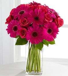 love gerber daisies and roses together. Green with a splash of purple would be perfect!