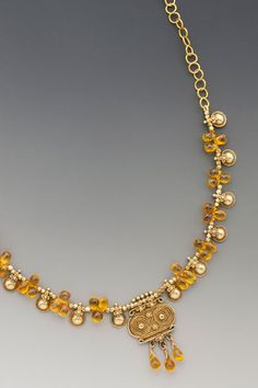 Bedazzled: An antique 20K-22K Indian thali is flanked by semi-transparent faceted yellow sapphire drops interspersed with antique 20K-22K Indian beads from the state of Orissa. On 18K gold hand-made chain.