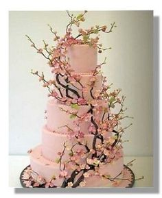 4 tiers of beautiful blossoms, on this wedding cake .... great for a spring wedding. I can imagine fresh blossoms being used as centerpieces