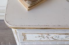 Eloquence® Bronte Nighstand in Fleur De Lis finish. Perfectly suited for your European style bedroom! Enjoy the beautiful shape along with an abundance of storage space in 3 drawers. The unique finish features gold highlights around the delicate carvings and edges, perfect for a touch of glamour in your boudoir. <br><br> <strong>Eloquence Collection</strong><br> Crafted with such elegance that it needs no explanation, the Eloquence Collection captures the essence of 19th-century elegance....