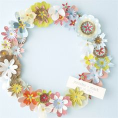 DIY instructions for making this paper flower wreath made from paper scraps!