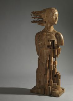 Taiwanese Sculpture Uses Wood To Create Sculptures Of People - Taiwanese sculpture uses wood to create sculptures of people effected by pixelated glitches