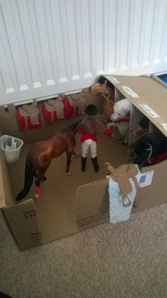 I have make these breyer stables out of a cardboard box, plastic yogurt containers, staples and paper ... I have bought the horses and the tack online from the breyer store although I make their blankets out of a square sheet on patterned material about their size