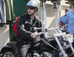 Justin Timberlake on his Harley with his red Refugee bag