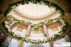 The stunning floral mandap built and decorated by Flower Power which was the focal point of the wedding at Stowe School.
