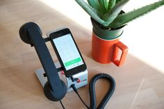 The POP Desk is a handheld receiver and angled stand for smartphones. It's a great way to make mobile, Skype, or VoIP calls in style