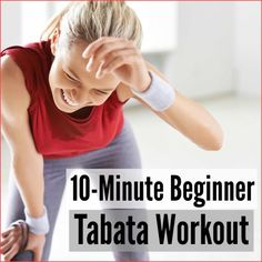 A fitness woman in a gym wiping the sweat off of her brow after a tabata interval workout.