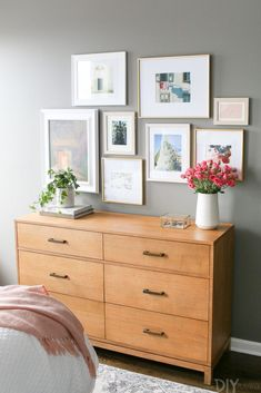 Love a gallery wall over a dresser. To keep the dresser from being too bare, I added accessories from HomeGoods. Love that they sell hardcover coffee table books with gorgeous spines! Such a good piece of decor to display and add height. Bedroom Decor For Women, Home Decor Bedroom, Bedroom Ideas For Women On A Budget, Bedroom Inspo, Gallery Wall Bedroom, Bedroom Wall, Master Bedroom, Small Apartment Decorating, Apartment Ideas