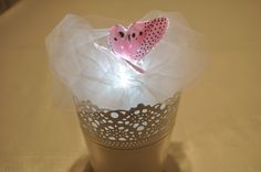 Pink Sparkle Lite Butterfly on a White Sparkle Lite Base in a simple tulle arrangement.