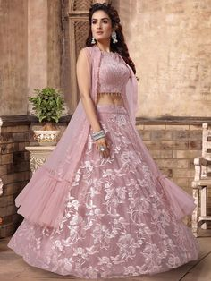 Shop Party wear pink net lehenga choli online from India. Gown Party Wear, Party Wear Indian Dresses, Designer Party Wear Dresses, Indian Gowns Dresses, Indian Bridal Outfits, Party Wear Lehenga, Indian Fashion Dresses, Indian Bridal Wear, Kurti Designs Party Wear