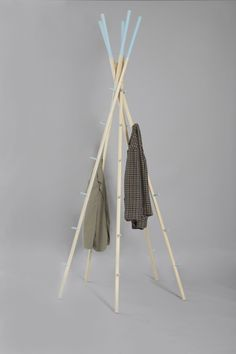 "Tent is a minimal design created by England-based designer Federico Floriani. The design is comprised of five poles that interlock with each other. They form their own support system in which coats and hats can be hung on their individual hooks. Large items such as luggages and bags can be placed inside the ""tent"" as well. (2)"