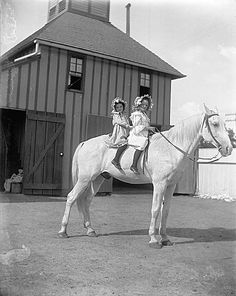 Erwin E. Smith Collection Guide | Collection Guide ~ Two girls on a horse before a carriage house, 1908-1915