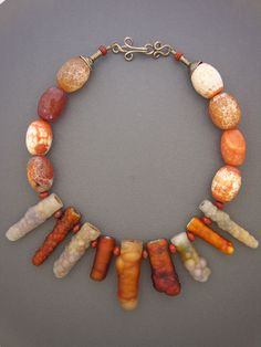 """A second fossilized bamboo necklace from Dorje Designs. """"...The individual beads of fossil bamboo that make up this necklace are millions of years old, and their unique colors, patterns, and shapes will guarantee you something to talk about for years to come. Fire agates and jasper spacers, with a fancy sterling silver hook and eye clasp, complete this necklace."""""""