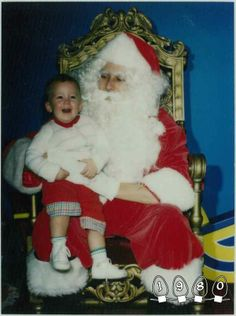 1980: Mike, at 1, begins the annual tradition with his first photo with Santa. | Heartwarming Photos Of Two Brothers Who Have Taken A Picture With Santa Together For 30 Years