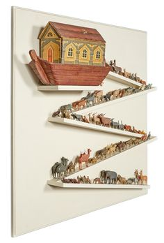 German Painted and Lithographed Noah's Ark. With over ninety carved and painted animals and Figures; Together with a Custom Display Panel.