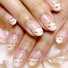 Funky Fingers Factory has highlighted the traditional French manicure then highlights the nail tip with rhinestones and Glitter.…