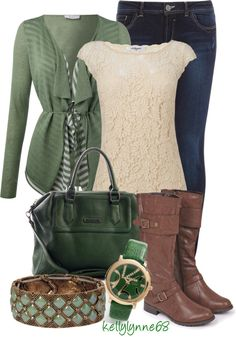 Green sweater over lace cream top.